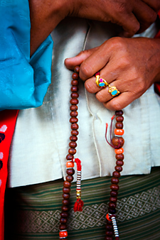 Tibetan woman with Buddhist prayer beads