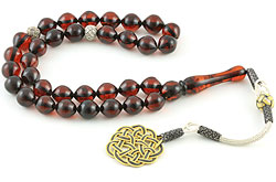 Islamic prayer beads (masbaha) of Baltic amber with knitted silver tassel and marker beads
