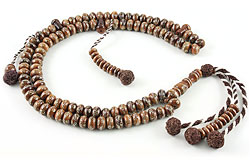 Muslim prayer beads (subha) of walnut inlaid with sterling silver